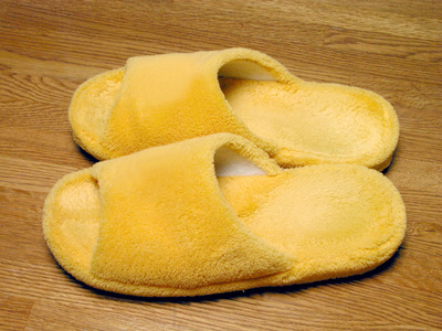 Plush slippers on a wooden floor