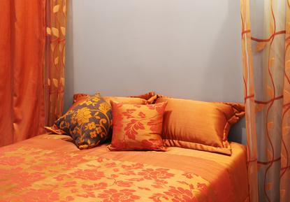 orange curtains in bedroom